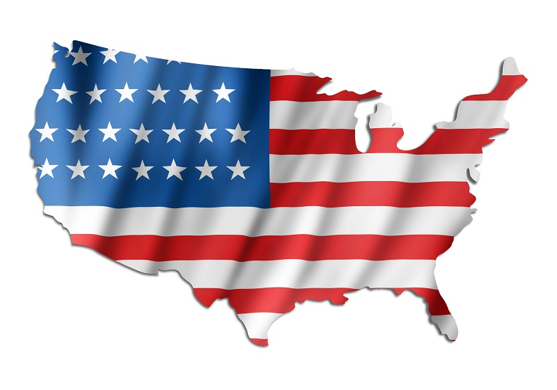 A map of the United States with a U.S. flag image superimposed over the map.
